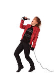 Rocking woman in a red leather jacket Royalty Free Stock Photography