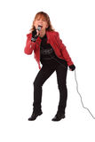 Rocking woman in a red leather jacket Royalty Free Stock Images