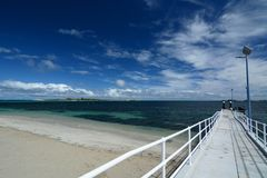 Shoalwater beach jetty and, in the backgroung, Penguin island. Rockingham. Western Australia stock photo