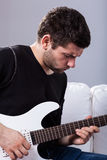 Rockman playing electric guitar Stock Photo