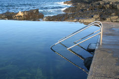 Rockpool. Ladder submerged in water - Kiama NSW Australia Stock Image