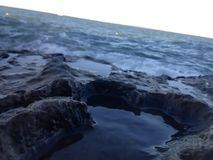 Rockpool. By the beach Stock Image