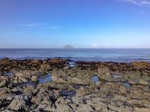 Rockpools and Isle of Craig, Scotland royalty free stock photos