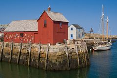 Rockport. Famous red fishing shack with sailboat  in Rockport Massachusetts (New England Stock Images