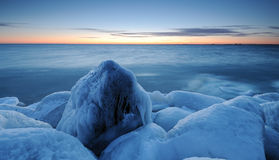 Rocks. Filled with ice taken  by the sea after sunset Royalty Free Stock Images