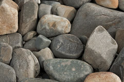 Rocks. A pile of naturally smooth rocks by the sea Royalty Free Stock Photography