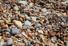 Rocks. Pebbles on brighton beach in UK in a sunny day stock photography