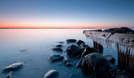 Rocks. Beach with some old worn wood and stone Royalty Free Stock Photos