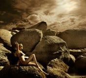 Rocks. A beautiful woman laying on the rocks Royalty Free Stock Photography