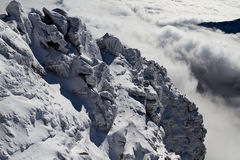 Rocks above the clouds. View from Lomnicky Peak (2634 m), High Tatras mountains, Slovakia Royalty Free Stock Photography