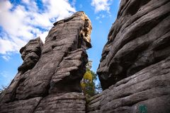 Rocks against the blue sky and forest royalty free stock photo