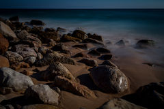 Rocks along the coast stock photos