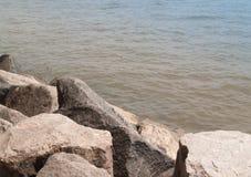 Rocks along river's edge. Large boulders edge the river banks in Virginia Stock Photo