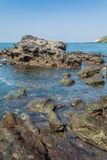 Rocks at anjuna beach goa Stock Images