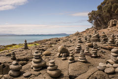 Rocks arranged next to the ocean Royalty Free Stock Image