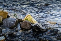 Rocks And Artificial Historic Column On Seashore Royalty Free Stock Photo