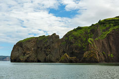 Rocks in Avacha Bay of the Pacific Ocean. The coast of Kamchatka. Royalty Free Stock Images