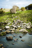 Rocks on the bank. A collection of large rocks on the banks of a small river Royalty Free Stock Photography