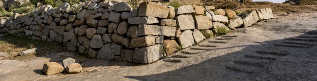 Rocks Basement / Wall Building aside a pathway Background stock image