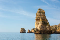 Rocks bathing in Atlantic in Lagos, Portugal Stock Photography