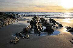 Rocks on the Beach. A beach landscape full of rocks and sand Stock Image