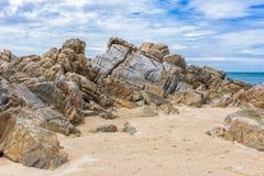 Rocks on beach. Beautiful rocks on beach with blue sky Royalty Free Stock Photo