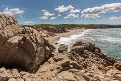 Rocks and beach on the coast of Sardinia near Rena Majore Royalty Free Stock Image