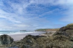 Rocks on the Beach at Gwithian. A view of the beach at Gwithian across the rocks stock photography