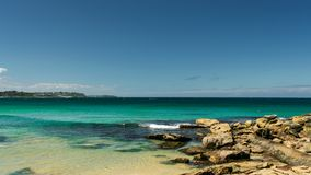 Rocks on the beach with horizon in the background - Manly Beach,. Sydney, Australia Royalty Free Stock Images