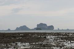 Rocks beach with island in background. Ton Sai, Thailand. Karst rocks beach with island in background in Ton Sai, Thailand Royalty Free Stock Photo