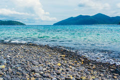 Rocks Beach at lipe island in Thailand. Sea and rocks in daylight at lipe island stock image