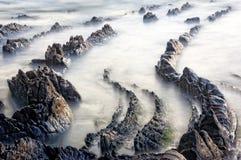 Rocks on beach. With long exposure Stock Photo