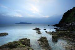 Rocks on beach. Many rocks on the beach under cloudy sky Stock Photos