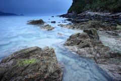 Rocks on beach. Many rocks on the beach under cloudy sky Stock Images