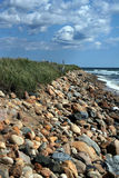 Rocks on beach in montauk. A view of dramatic clouds and rocks on the beach in Montauk, new York Royalty Free Stock Photo