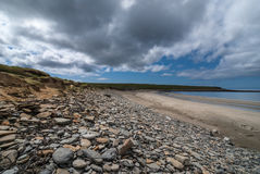 Rocks on the beach and ocean bay at Skara Brae. Royalty Free Stock Images