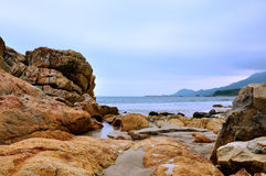 Rocks on beach by sea Royalty Free Stock Image