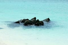 Rocks on the beach in the sea. Large rocks on the sand along the length of the beach Stock Photo
