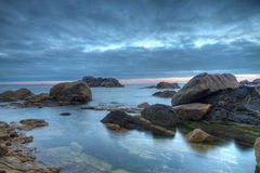 Rocks on beach Stock Image