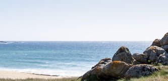 Rocks in the beach. In a sunny day Royalty Free Stock Photos
