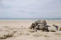 Rocks on beach. On a sunny day Stock Photo