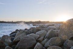 Rocks on beach. Rocks on the beach in sunset near Halifax on the Atlantic Ocean Stock Photos