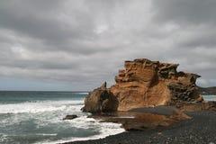 Rocks on a beach Stock Photos