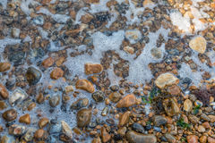 Rocks on a beach. Rocks washed away by the waves on the beach. Whitstable, England 2017 May Stock Photos