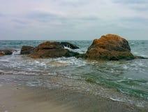 Rocks on beach Stock Photo