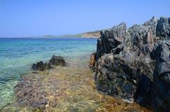 Rocks at the beautiful wild beach Stock Photo