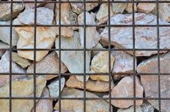 Rocks behind iron grid Stock Photography