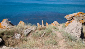 Rocks on black sea Royalty Free Stock Image