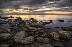 Rocks and Black sea at sunset Stock Photos