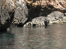 Rocks in the Blue Grotto. A picture from a boat near the blue grotto in malta Royalty Free Stock Images
